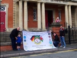 Councillor Paul Pemberton signing the Wrexham DSA flag for Munich on behalf of Rhos Community Council